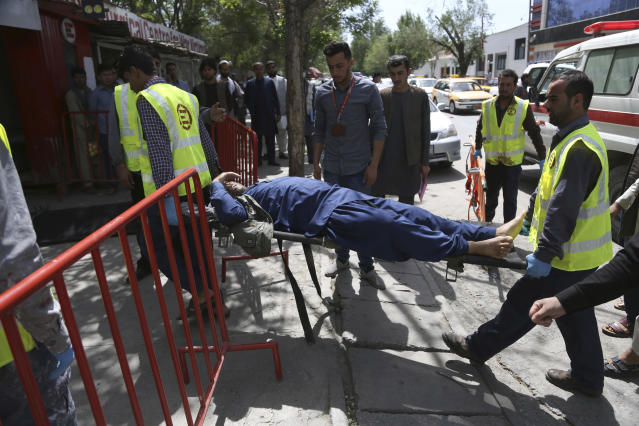 <p>Afghan men carries a wounded man after the second blast in Kabul, Afghanistan, April 30, 2018. (Photo: Rahmat Gul/AP) </p>