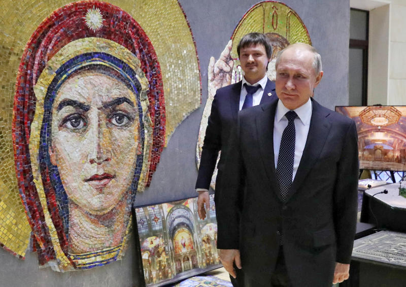 Russian President Vladimir Putin visits an exhibition ahead of an annual meeting with top military officials in the National Defense Control Center in Moscow, Russia, Tuesday, Dec. 24, 2019.Putin said that Russia is the only country in the world that has hypersonic weapons even though its military spending is a fraction of the U.S. military budget. (Mikhail Klimentyev, Sputnik, Kremlin Pool Photo via AP)