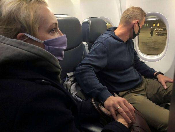 PHOTO: Russian opposition leader Alexei Navalny and his wife Yulia Navalnaya are seen on board a plane after landing at Sheremetyevo airport in Moscow, Jan. 17, 2021. (Polina Ivanova/Reuters)