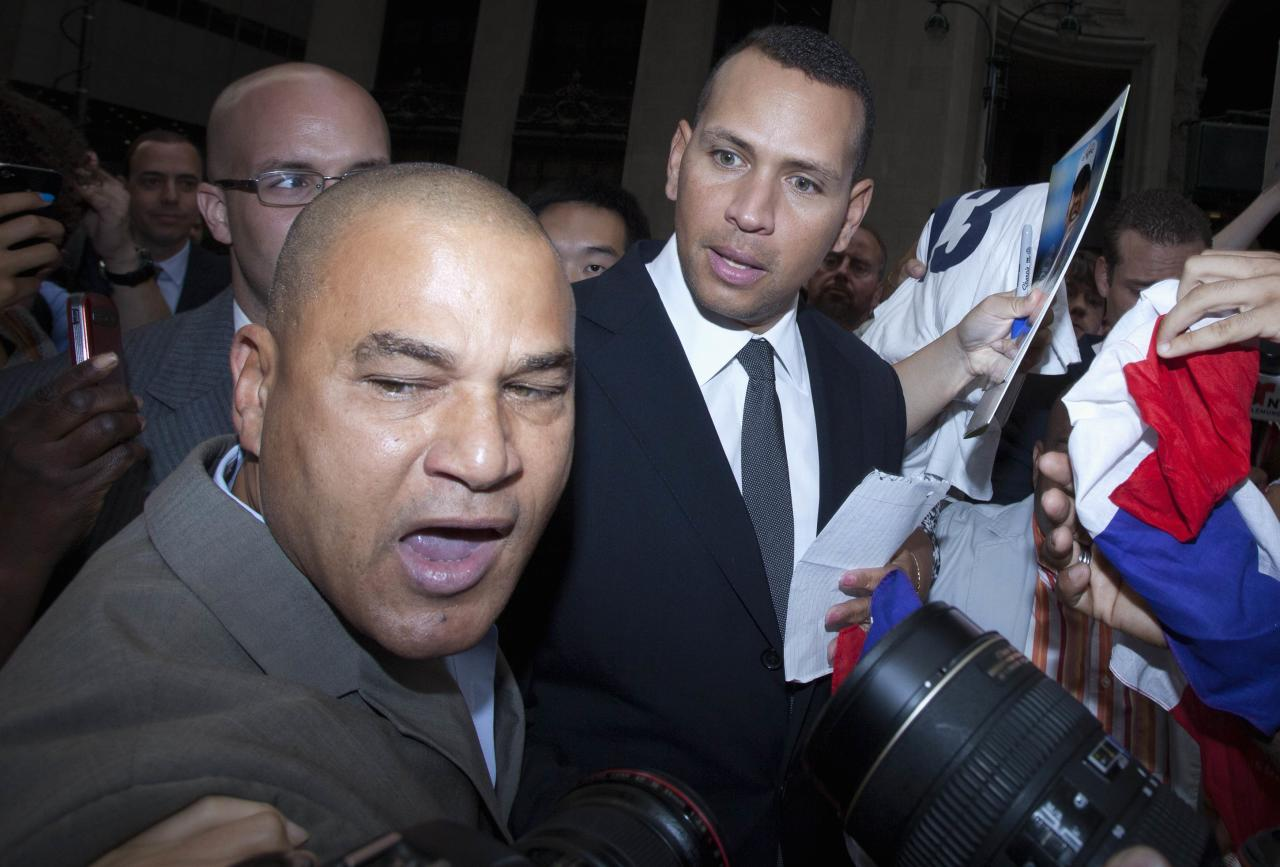 New York Yankees baseball player Alex Rodriguez is surrounded by supporters after leaving Major League Baseball's headquarters in New York, October 4, 2013. Yankees' Rodriguez has sued Major League Baseball (MLB) and Commissioner Bud Selig and accused them of trying to destroy his reputation and his career. MLB responded to the lawsuit by issuing their own statement, denying the allegations made by Rodriguez and accusing him of trying to circumvent the grievance process of the league and its players. REUTERS/Carlo Allegri (UNITED STATES - Tags: CRIME LAW DRUGS SOCIETY SPORT BASEBALL)