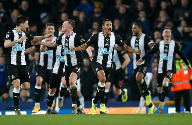 Newcastle's Isaac Hayden, centre, and his team-mates celebrate their equalising goal (Martin Rickett/PA)