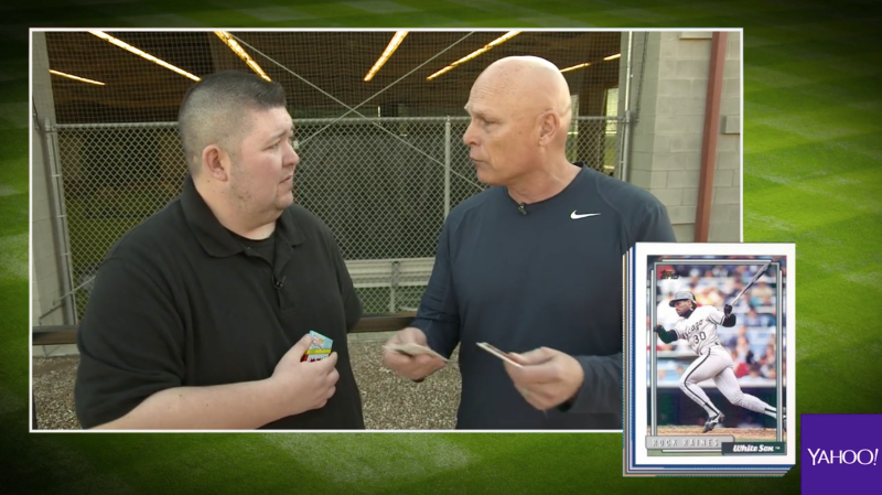 Indians bench coach Brad Mills opening 25-year-old baseball cards. (Yahoo Sports)