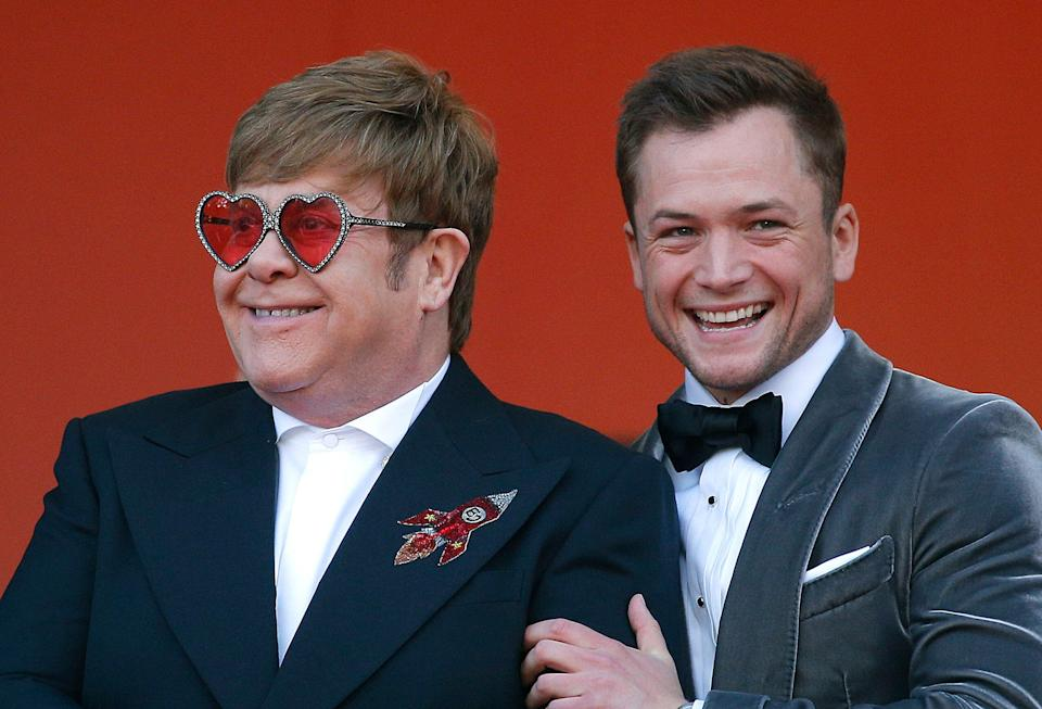 """72nd Cannes Film Festival - Screening of the film """"Rocketman"""" out of competition - Red Carpet Arrivals - Cannes, France, May 16, 2019. Elton John poses with Taron Egerton. REUTERS/Stephane Mahe"""