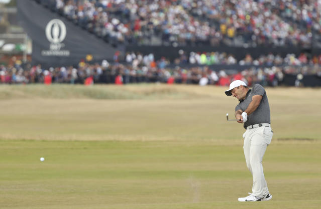 FILE- In this July 22, 2018, file photo Francesco Molinari of Italy plays a shot to the 17th green during the final round for the 147th British Open Golf championships in Carnoustie, Scotland. Molinari says this 2-iron was one of the biggest shots he hit in the final round. (AP Photo/Peter Morrison, File)