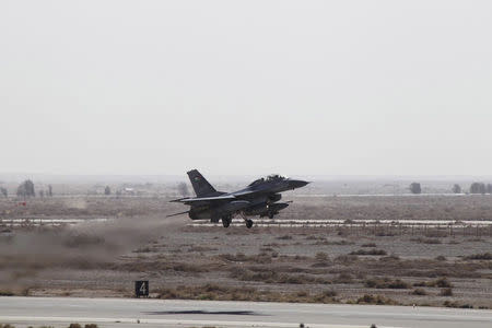 A Royal Air Force plane takes off from an air base to strike the Islamic state in the Syrian city of Raqqa