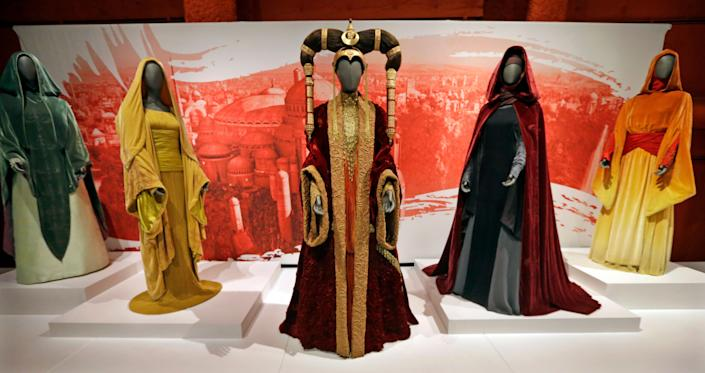 The Senate gown of Queen Amidala, center, is seen with handmaiden gowns. (AP Photo/Elaine Thompson)