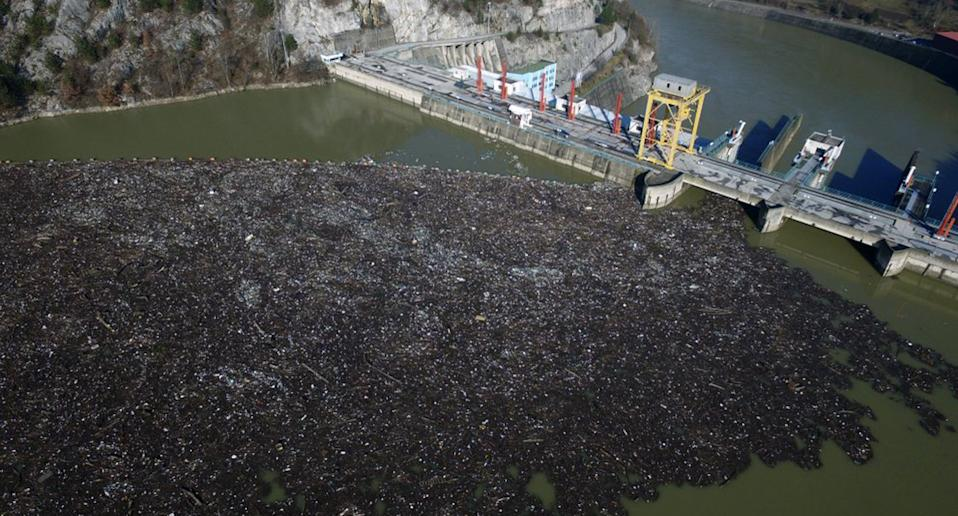 This is aerial photo shows plastic bottles, wooden planks, rusty barrels and other garbage clogging the Drina river near the eastern Bosnian town of Visegrad, Bosnia