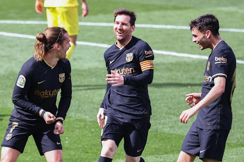 <p>Barcelona celebrate their win at Villarreal</p> (AFP via Getty Images)