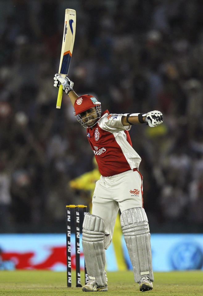 Kings XI Punjab's Paul Valthaty celebrates after scoring a century during an Indian Premier League cricket match between Kings XI Punjab and Chennai Super Kings in Mohali, India, Wednesday, April 13, 2011.
