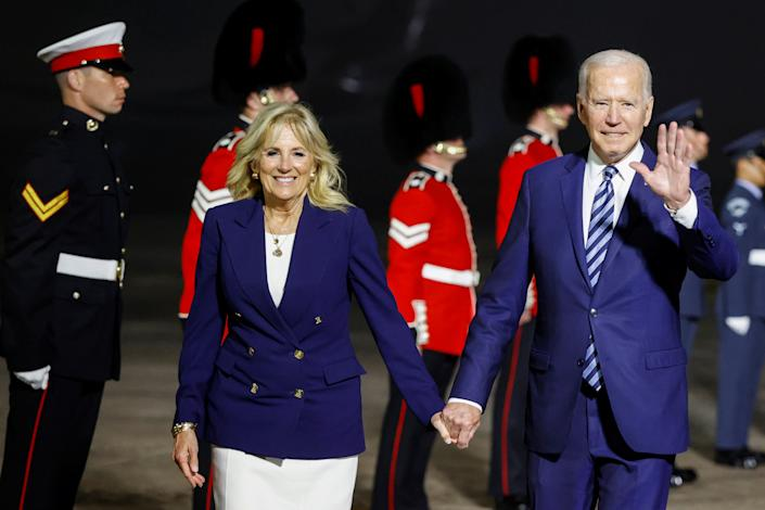 NEWQUAY, ENGLAND - JUNE 09: U.S. President Joe Biden and first lady Jill Biden react upon arrival at Cornwall Airport Newquay, on June 9, 2021 near Newquay, Cornwall, England. On June 11, Prime Minister Boris Johnson will host the Group of Seven leaders at a three-day summit in Cornwall, as the wealthiest nations look to chart a course for recovery from the global pandemic. (Photo by Phil Noble - WPA Pool/Getty Images)