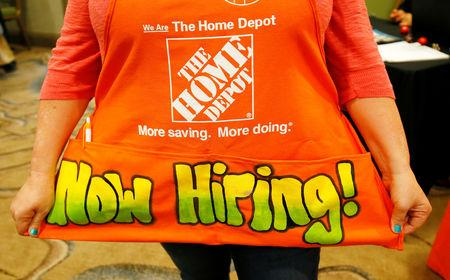 FILE PHOTO: A recruiter for Home Depot is seen at a job fair in Golden, Colorado, June 7, 2017. REUTERS/Rick Wilking/File Photo
