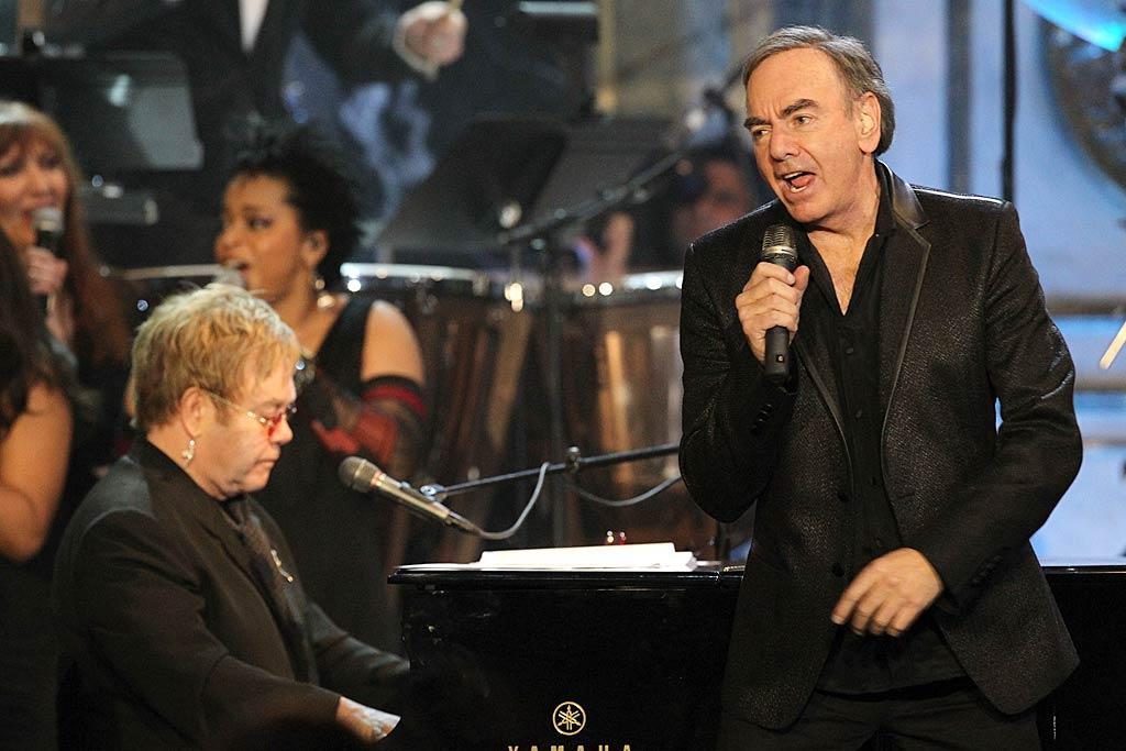 "Neil Diamond had to wait until he turned 70 to be get in to the exclusive ""club,"" but better late than never! After Paul Simon presented the cool crooner's induction, Diamond sang three of his hits, including his sing-a-long fave ""Sweet Caroline,"" while Elton John backed him up on the piano. Kevin Crane/<a href=""http://www.wireimage.com"" target=""new"">WireImage.com</a> - March 14, 2011"