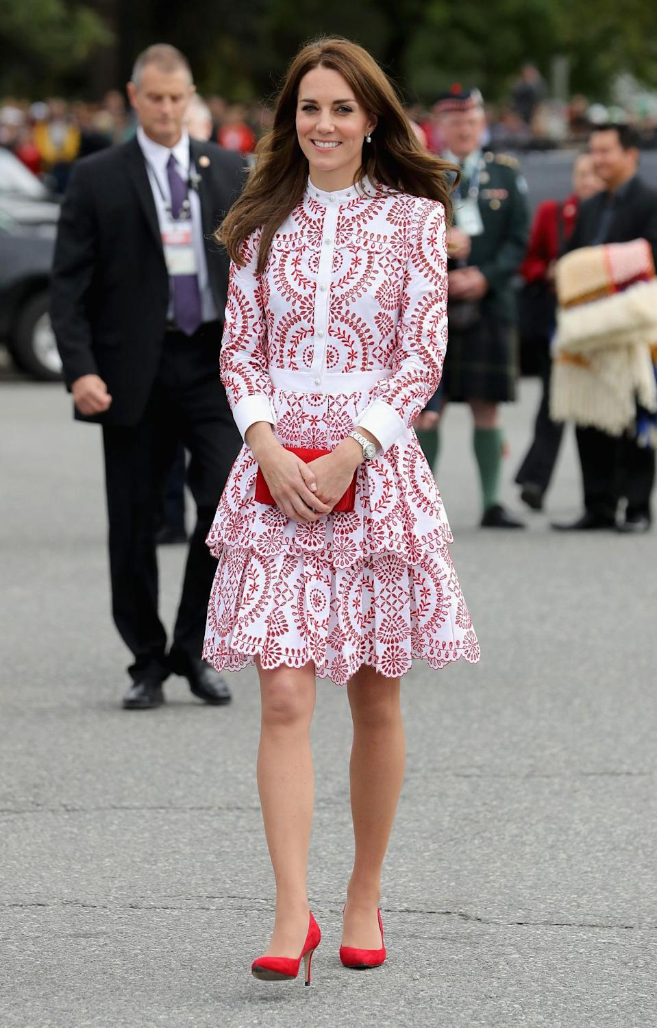 <p>The Duchess donned a bespoke red-and-white Alexander McQueen dress for a day in Vancouver. A matching Miu Miu bag and red suede heels topped off the look.</p><p><i>[Photo: PA]</i> </p>