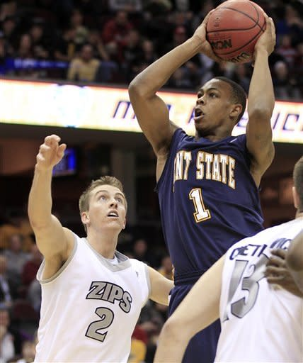 Kent State's Eric Gaines (1) shoots over Akron's Brian Walsh (2) during the first half of an NCAA college basketball game in the semifinals of the Mid-American Conference men's tournament, Friday, March 9, 2012, in Cleveland. (AP Photo/Tony Dejak)
