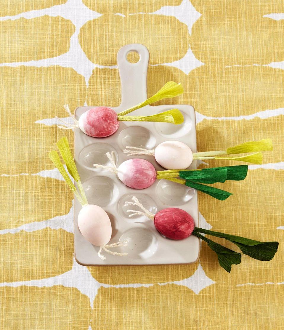 "<p>Good enough to eat, these radish eggs can either be painted or dyed.<strong><br></strong></p><p><strong>To make:</strong> Paint or dye three-quarters of a blown-out white egg pink. Create roots by attaching pieces of off-white twine to the bottom with hot-glue. Roll up light green crepe paper to create a stem; seal seam with glue. Cut leaves from crepe paper; wrap around stem, and attach with glue. Glue stem to top of egg.</p><p><a class=""link rapid-noclick-resp"" href=""https://www.amazon.com/Just-Artifacts-Premium-Crepe-Paper/dp/B07BTDZTM8/ref=sr_1_1_sspa?tag=syn-yahoo-20&ascsubtag=%5Bartid%7C10050.g.1652%5Bsrc%7Cyahoo-us"" rel=""nofollow noopener"" target=""_blank"" data-ylk=""slk:SHOP CREPE PAPER"">SHOP CREPE PAPER</a><br></p>"