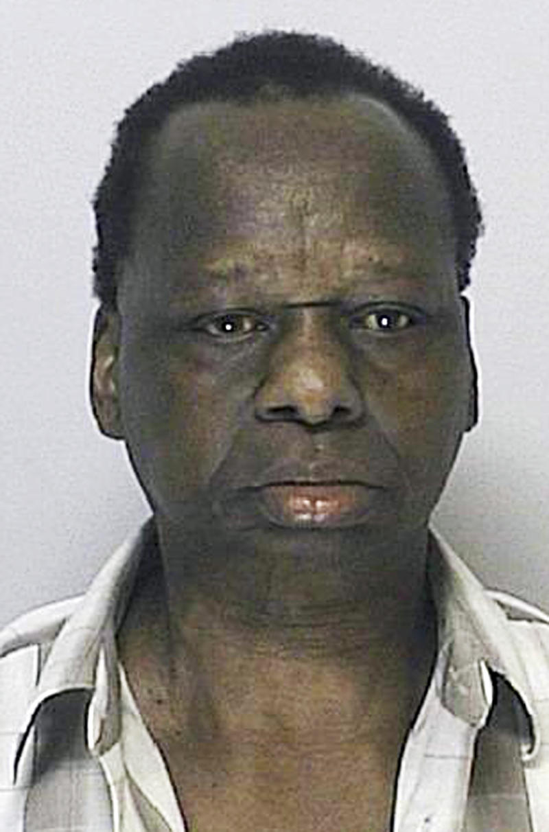 RETRANSMITTING IN COLOR - This Aug. 24, 2011 booking photo provided Aug. 30, 2011 by the Framingham Police Department shows Onyango Obama, arrested in Framingham, Mass., for several infractions, including operating a motor vehicle  under the influence of alcohol. He is the uncle of President Barack Obama. (AP Photo/Framingham Police Department)