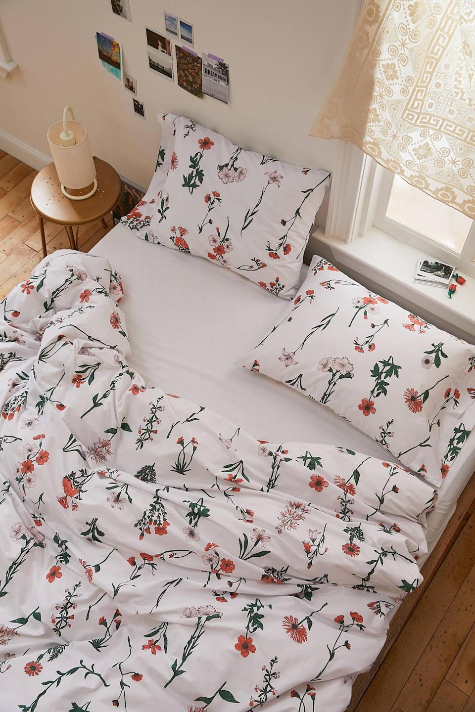 """<br> <br> <strong>Urban Outfitters</strong> Georgina Stems Duvet Set, $, available at <a href=""""https://go.skimresources.com/?id=30283X879131&url=https%3A%2F%2Fwww.urbanoutfitters.com%2Fshop%2Fgeorgina-stems-duvet-set"""" rel=""""nofollow noopener"""" target=""""_blank"""" data-ylk=""""slk:Urban Outfitters"""" class=""""link rapid-noclick-resp"""">Urban Outfitters</a>"""