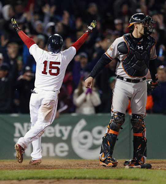 Boston Red Sox's Dustin Pedroia (15) reacts behind Baltimore Orioles' Matt Wieters after scoring on a throwing error by David Lough in the ninth inning of a baseball game in Boston, Sunday, April 20, 2014. The Red Sox won 6-5. (AP Photo/Michael Dwyer)