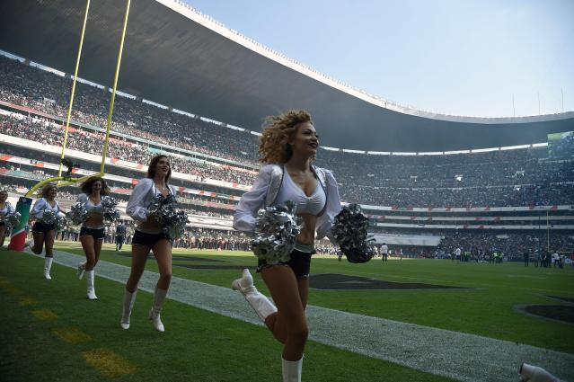 <p>Oakland Raiders´ cheerleaders perform during the 2016 NFL week 11 regular season football game against New England Patriots' on November 19, 2017 at the Azteca Stadium in Mexico City. / AFP PHOTO / ALFREDO ESTRELLA (Photo credit should read ALFREDO ESTRELLA/AFP/Getty Images) </p>