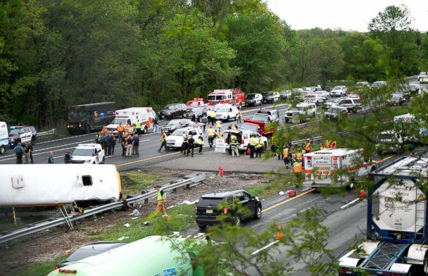 PHOTO: Emergency personnel work at the scene of a school bus and dump truck collision on Interstate 80 in Mount Olive, N.J., May 17, 2018. (Ed Murray/NJ Advance Media via AP)