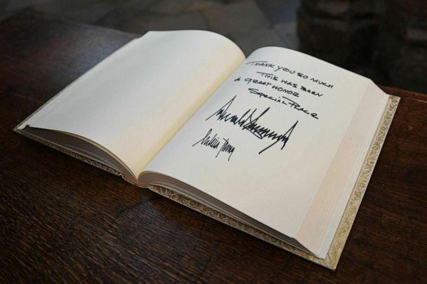 PHOTO: The visitors books signed by US President Donald Trump and his wife Melania after their tour of Westminster Abbey in central London, June 3, 2019. (Stefan Rousseau/Pool via AP)