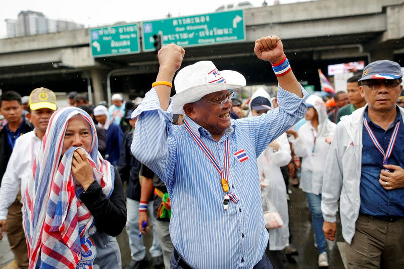 FILE PHOTO: Anti-government protest leader Suthep gestures to his supporters after a Thai court delivered its verdict on PM Yingluck, in Bangkok