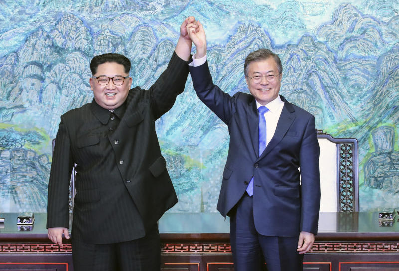 FILE - In this April 27, 2018 file photo, North Korean leader Kim Jong Un, left, and South Korean President Moon Jae-in raise their hands after signing a joint statement at the border village of Panmunjom in the Demilitarized Zone, South Korea. South Korea's liberal president faces growing skepticism at home about his engagement policy ahead of his third summit with North Korean leader Kim Jong Un. A survey showed nearly half of South Koreans think next week's summit won't find a breakthrough to resolve a troubled nuclear diplomacy. It comes as Moon's approval rating is declining amid economic frustrations. (Korea Summit Press Pool via AP, File)