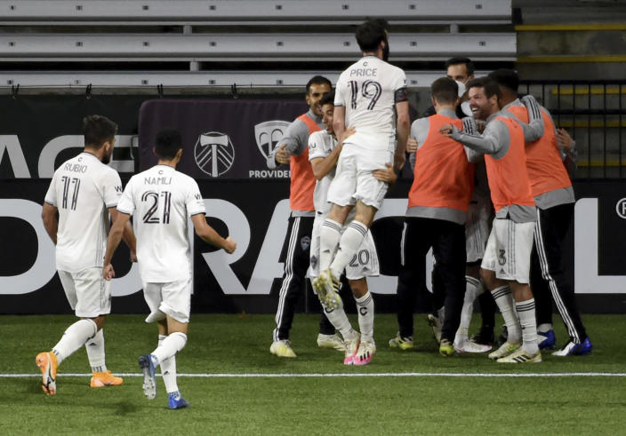 The Colorado Rapids celebrate after scoring a goal during the second half of an MLS soccer match against the Portland Timbers in Portland, Ore., Wednesday, Nov. 4, 2020. (AP Photo/Steve Dykes)