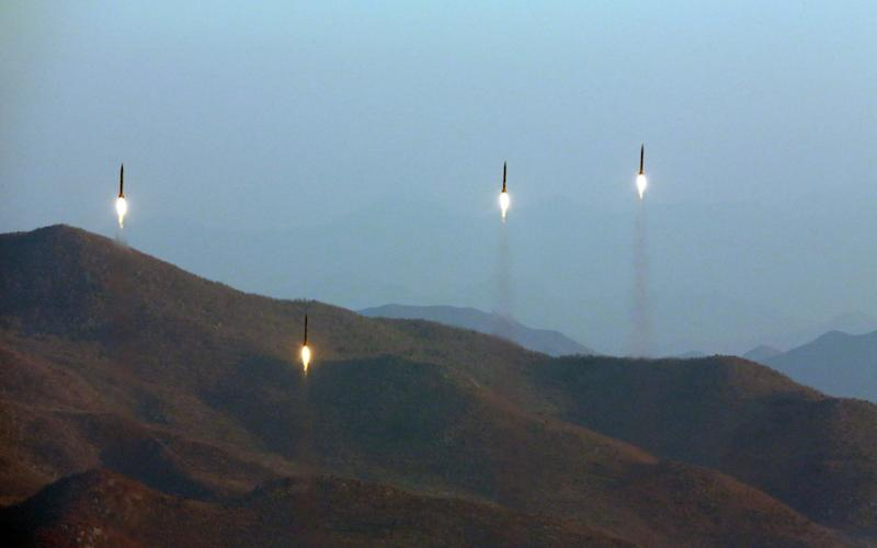 An undated file photo made available by the North Korean Central News Agency (KCNA), the state news agency of North Korea, on 07 March 2017, shows four projectiles during a ballistic rocket launching drill of Hwasong artillery units of the Strategic Force of the Korean People's Army (KPA) at an undisclosed location - KCNA
