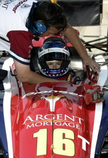Danica Patrick is helped into her car during practice for the Indianapolis 500 in 2005, the year she earned the title IndyCar Rooke of the Year