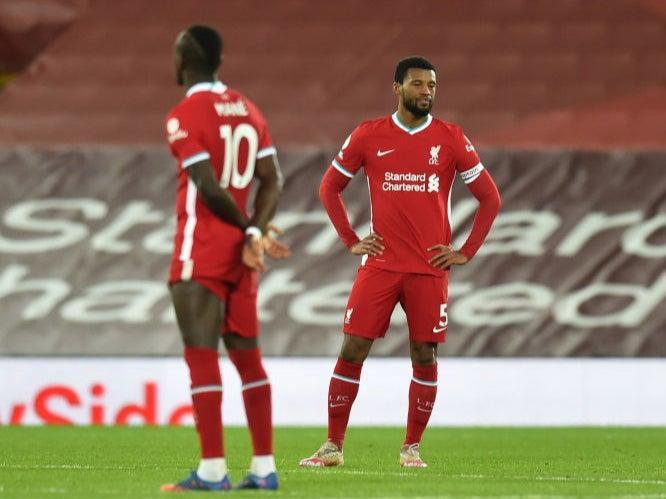 Liverpool's players react during defeat by EvertonLiverpool FC via Getty Images