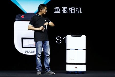 Ninebot President Wang Ye unveils delivery robot Segway DeliveryBot S2 at a Segway-Ninebot product launch event in Beijing