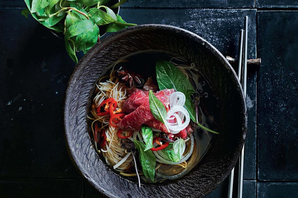 """This quick version of the classic Vietnamese soup is steeped with aromatic spices and finished off with refreshing herbs. <a href=""""https://www.epicurious.com/recipes/food/views/beef-pho?mbid=synd_yahoo_rss"""" rel=""""nofollow noopener"""" target=""""_blank"""" data-ylk=""""slk:See recipe."""" class=""""link rapid-noclick-resp"""">See recipe.</a>"""