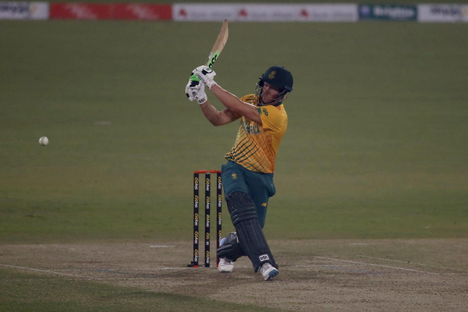 South Africa's David Miller plays a shot for boundary during the 3rd Twenty20 cricket match between Pakistan and South Africa at the Gaddafi Stadium, in Lahore, Pakistan, Sunday, Feb. 14, 2021. (AP Photo/K.M. Chaudary)