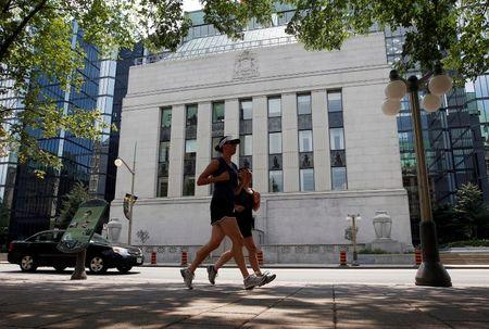 FILE PHOTO: Joggers run past the Bank of Canada building in Ottawa