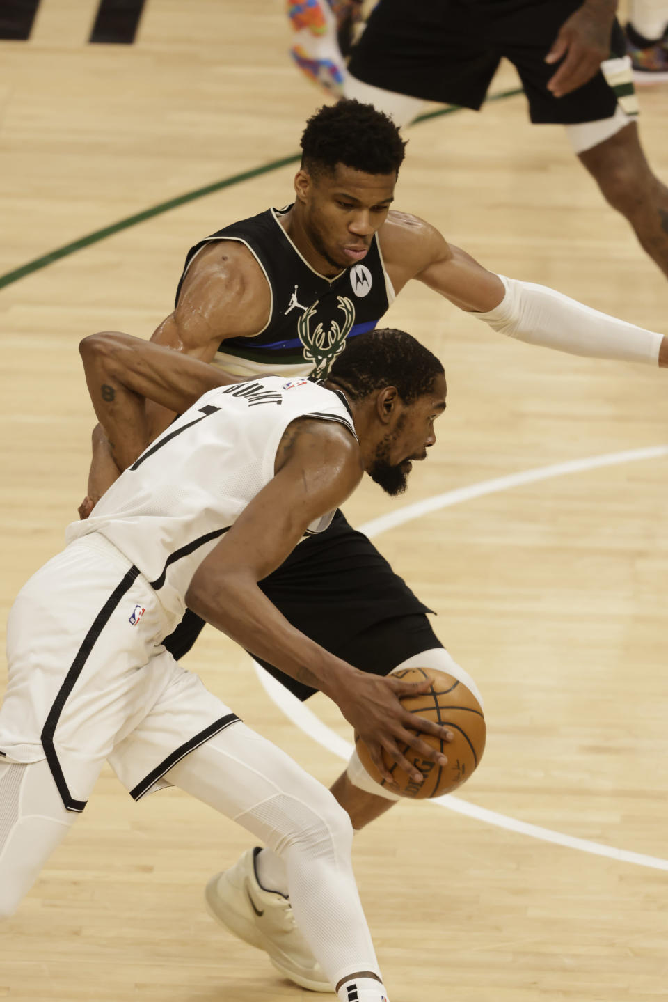 Milwaukee Bucks forward Giannis Antetokounmpo, top, guards against Brooklyn Nets' Kevin Durant during the second half of Game 6 of a second-round NBA basketball playoff series Thursday, June 17, 2021, in Milwaukee. (AP Photo/Jeffrey Phelps)