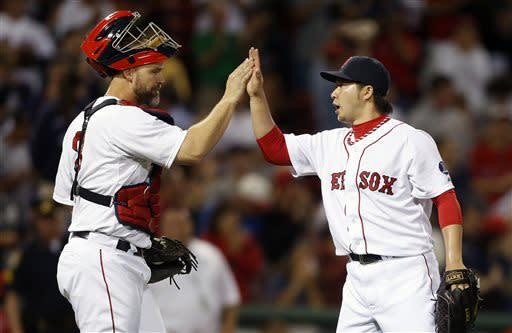 Boston Red Sox's Junichi Tazawa, right, and David Ross celebrate after defeating the Los Angeles Angels 7-2 in the second game of a baseball doubleheader in Boston, Saturday, June 8, 2013. (AP Photo/Michael Dwyer)