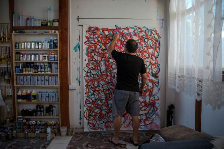 Ross says he was drawn to the slow vibe of Pancevo, across the Danube from Belgrade, after four years of making art in chaotic Bangkok (AFP Photo/Vladimir Zivojinovic)
