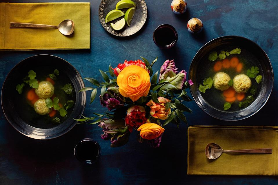 """This version of gondi is seasoned with cardamom, turmeric, and lime and best paired with a platter of green herbs. <a href=""""https://www.epicurious.com/recipes/food/views/matzo-ball-soup-with-cardamom-turmeric-and-lime?mbid=synd_yahoo_rss"""" rel=""""nofollow noopener"""" target=""""_blank"""" data-ylk=""""slk:See recipe."""" class=""""link rapid-noclick-resp"""">See recipe.</a>"""