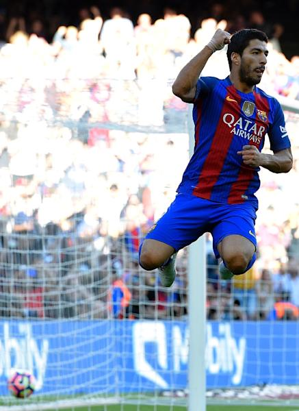 Luis Suarez for Barcelona's first goal in their 3-0 win over Deportivo la Coruna (AFP Photo/Lluis Gene)