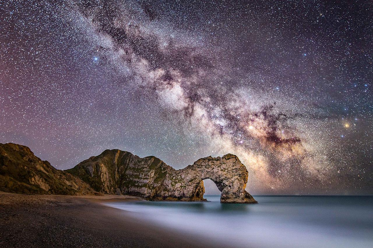 <p>An amazing capture of Dorset's Durdle Door rock formation with the impressive Milky Way behind it. (Photo: Stephen Banks/Caters News) </p>
