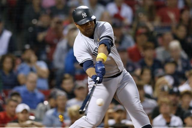 New York Yankees' Edwin Encarnacion hits an RBI double during the ninth inning of a baseball game against the Boston Red Sox in Boston, Saturday, Sept. 7, 2019. (AP Photo/Michael Dwyer)