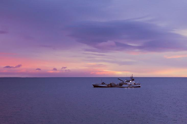 Dawn breaks as the ferry carries passengers from Punta Arenas to Porvenir.