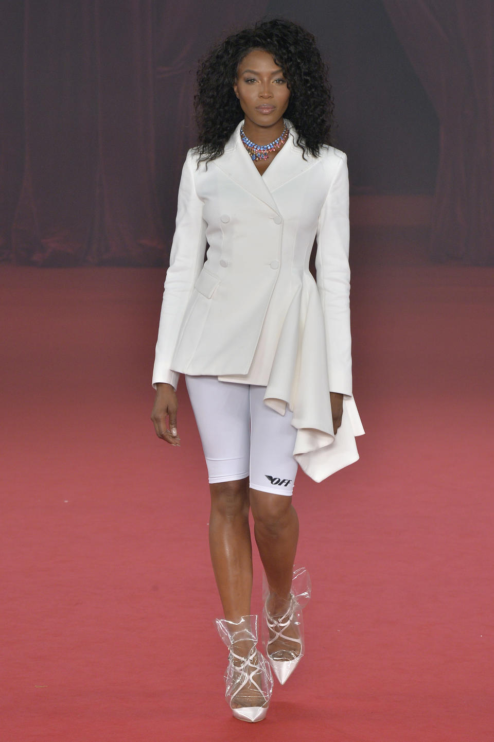 Naomi Campbell appears on the Off-White runway wearing bike shorts. (Photo: Getty)