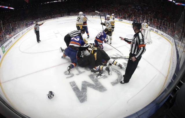 New York Islanders, in blue, fight with Pittsburgh Penguins moments after Islanders' Anthony Beauvillier (18) scored a goal during the second period of Game 2 of an NHL hockey first-round playoff series Friday, April 12, 2019, in Uniondale, N.Y. (AP Photo/Julio Cortez)