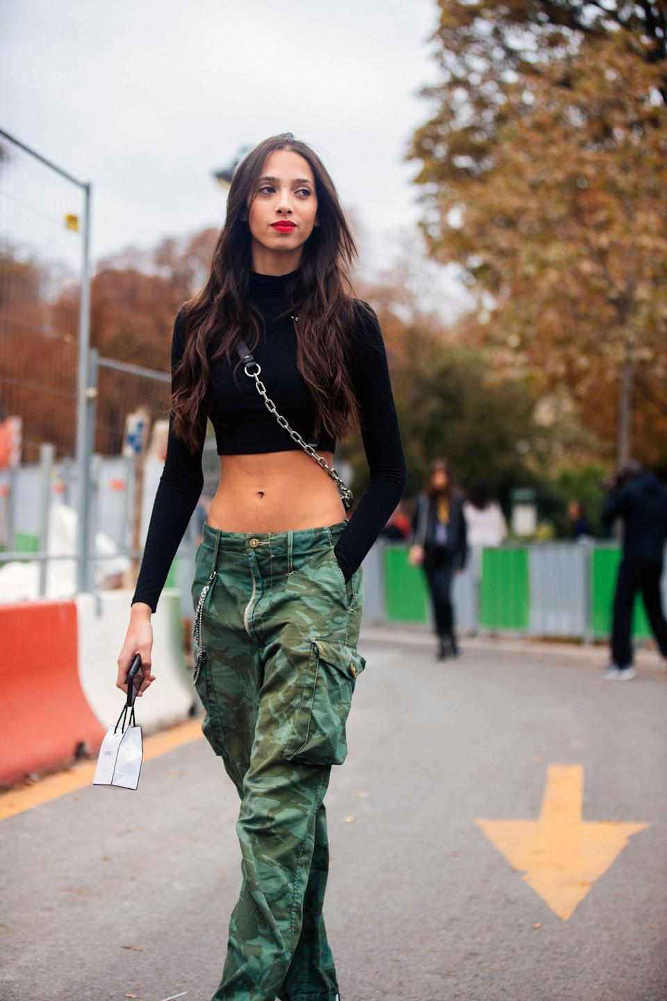 <p>. . . Or lean into the early 2000s vibes with camo cargos and a cropped top. </p>