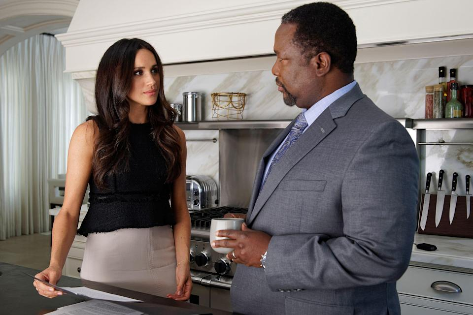 "Meghan Markle and Wendell Pierce on ""Suits."" (Photo: NBC Universal via Getty Images)"