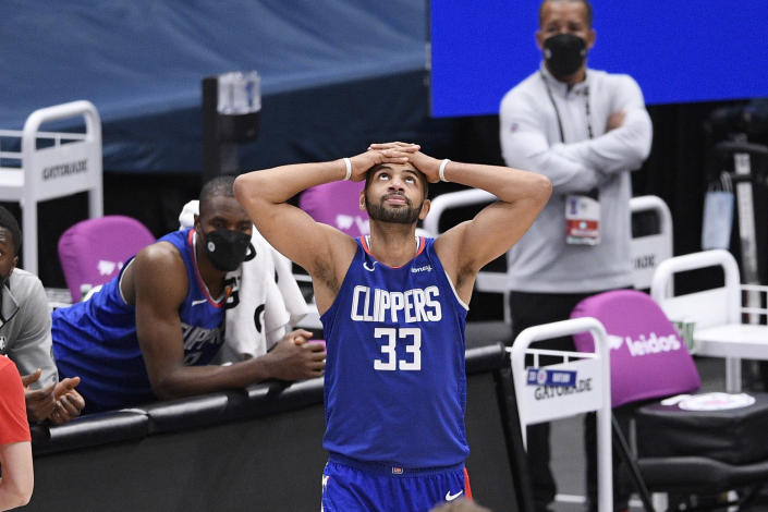 Los Angeles Clippers forward Nicolas Batum (33) reacts after he was called for a foul during the second half of an NBA basketball game against the Washington Wizards, Thursday, March 4, 2021, in Washington. (AP Photo/Nick Wass)