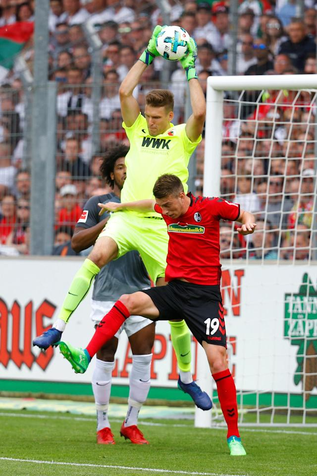 Soccer Football - Bundesliga - SC Freiburg v FC Augsburg - Schwarzwald-Stadion, Freiburg, Germany - May 12, 2018 Augsburg's Andreas Luthe gathers from SC Freiburg's Janik Haberer REUTERS/Kai Pfaffenbach DFL RULES TO LIMIT THE ONLINE USAGE DURING MATCH TIME TO 15 PICTURES PER GAME. IMAGE SEQUENCES TO SIMULATE VIDEO IS NOT ALLOWED AT ANY TIME. FOR FURTHER QUERIES PLEASE CONTACT DFL DIRECTLY AT + 49 69 650050