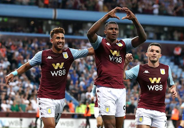 Aston Villa's Wesley (centre) celebrates scoring his side's first goal of the game with Trezeguet (left) and John McGinn during the Premier League match at Villa Park, Birmingham. (Photo by Nick Potts/PA Images via Getty Images)